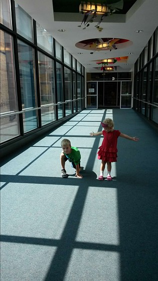 Kids posing in a downtown St. Paul Skyway
