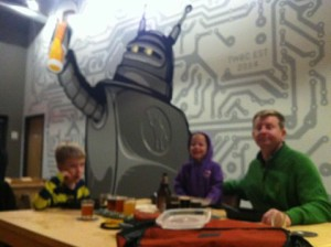 Family enjoying Tin Whiskers with Robot in background