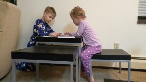 Kid's doing a project at the nesting tables.