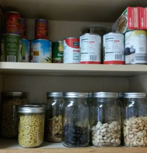 2 shelves. One with filling canning jars, one with regular groceries and cans from the store.