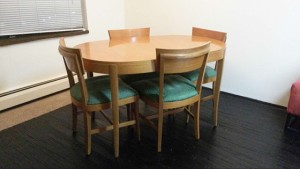 Mid-century table over temporary bamboo floors over carpet.