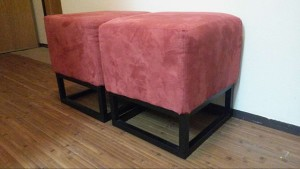 These are red boxy ottoman like stools.