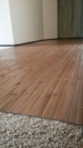 8' x 4' bamboo wall panels make great flooring over carpet.