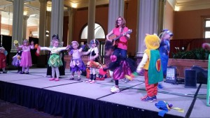 Kids dress in costume and dance on stage at the Landmark Halloween party.