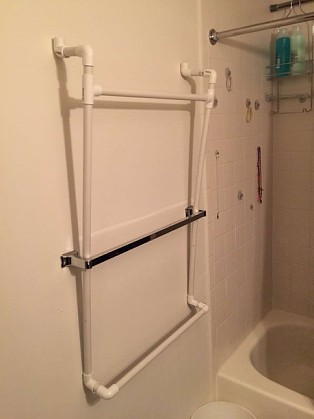 Marvelous PVC plumbing tubes are used to build extra towel bars