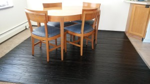 Bamboo wall panelling as a dining room rug.