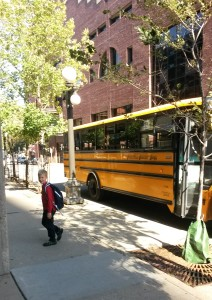 Getting off the bus from school.