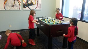 Kids playing foosball.
